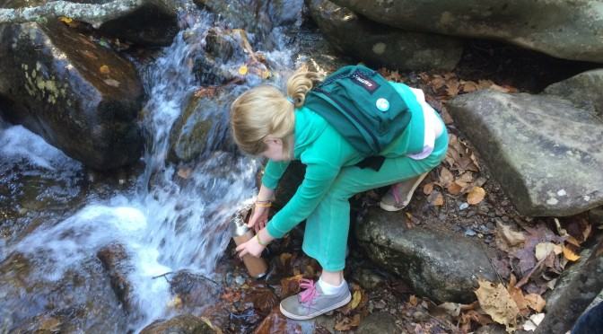 Jessie collecting water for a science project