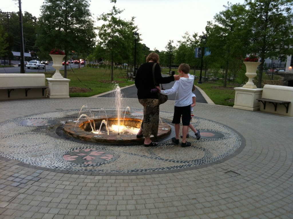 My wife, son, and daughter at a fountain at dusk