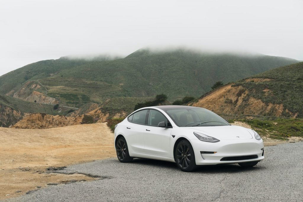 White Tesla Model 3 in the mountains
